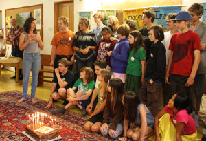 Zoe Miles presents a Forest Alphabet cake (baked by Trude) to youth artists